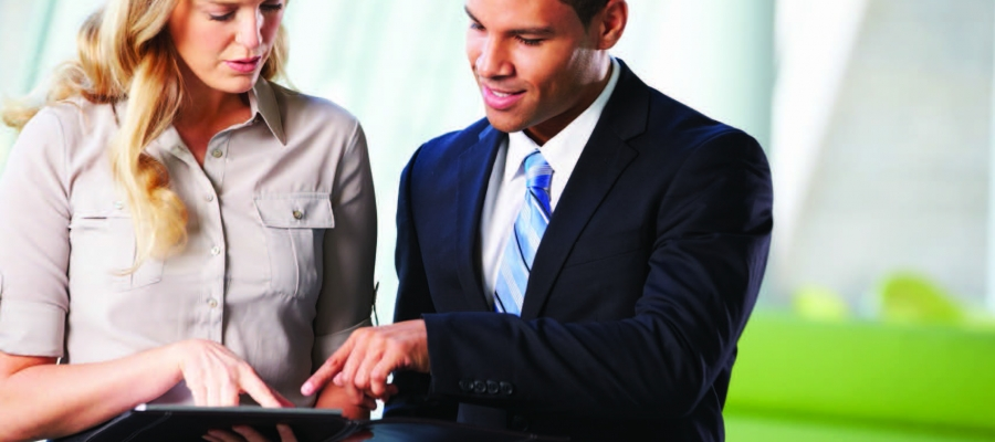 Two business people looking at tablet