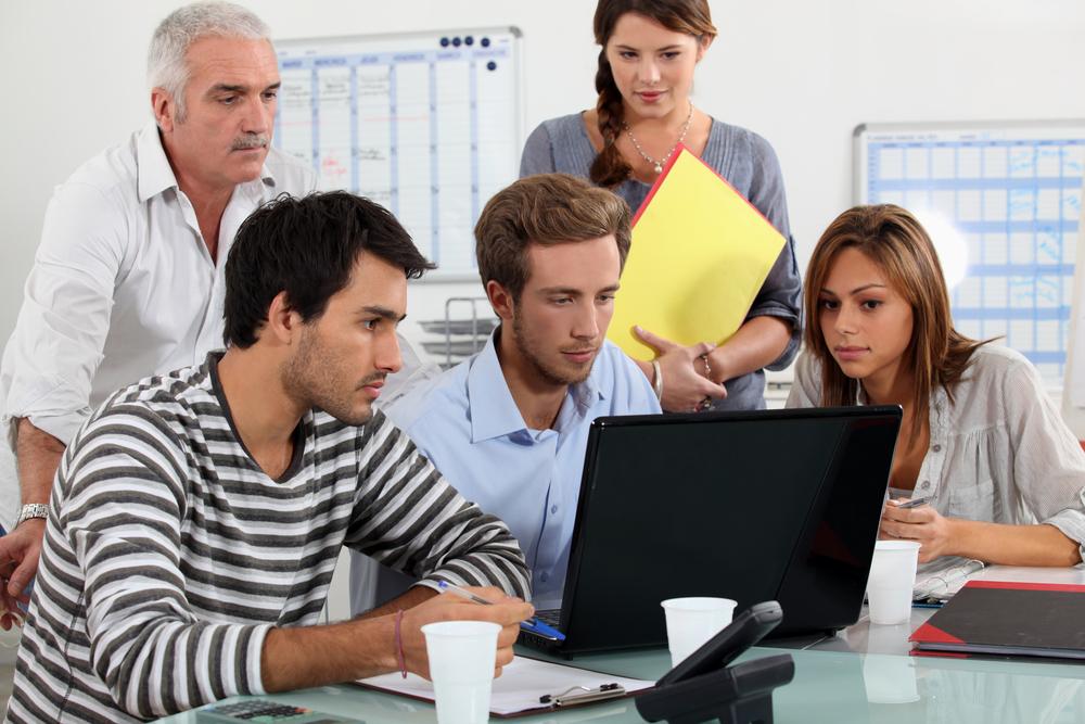 Team looking at computer