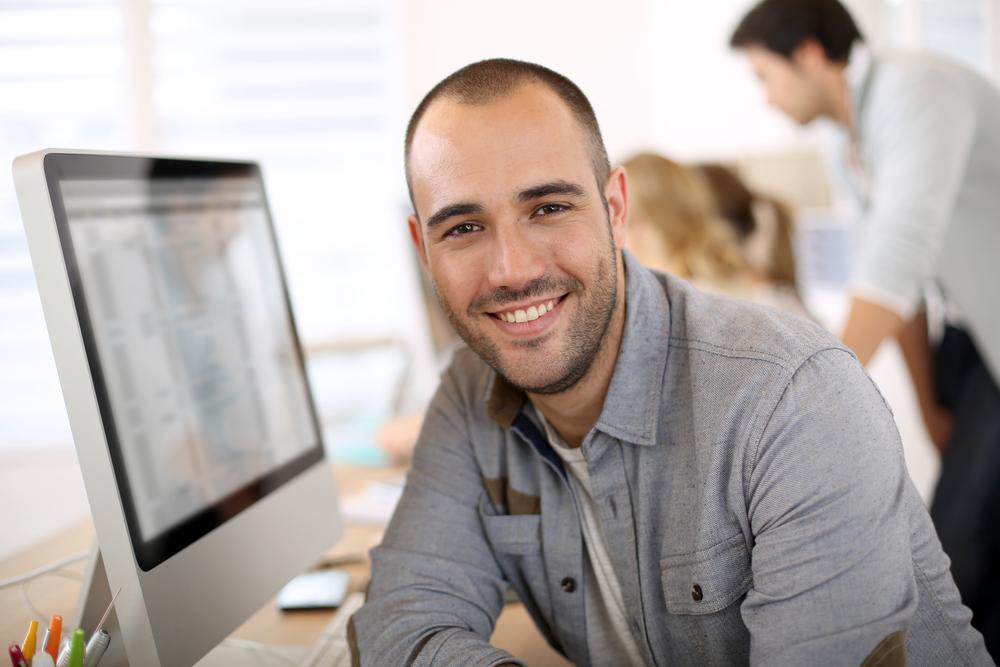 Sales guy behind a computer